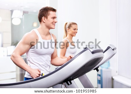 Young people in a fitness club - stock photo