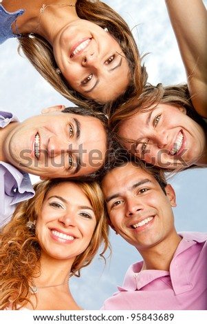 Young people in a group hug and smiling