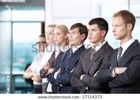 Young people in business suits look into the distance - stock photo