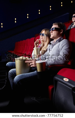 Young people in 3D glasses in cinema - stock photo