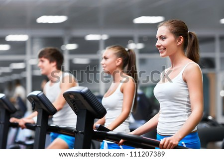 Young people in fitness club