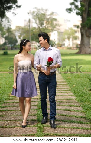 Young people in love dating in park