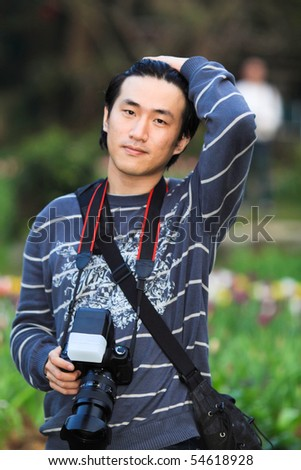 Young people in Taiwan with a camera in the park - stock photo