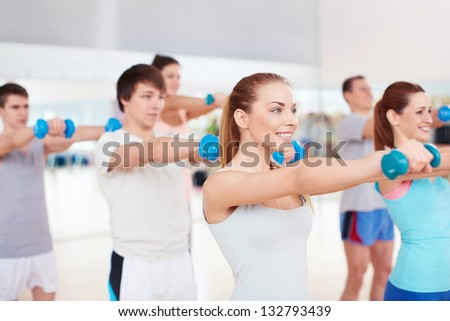 Young people in the gym - stock photo