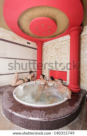 Young people in the hot tub - stock photo