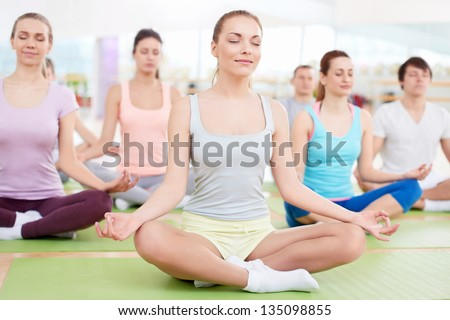 Young people in the lotus position