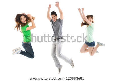 Young people jumping energetically against white background - stock photo