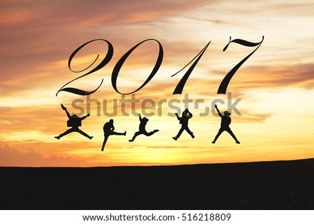 Young people jumping on the hill over cliff on sunset and clouds background for year 2016 and new year 2017, Business and best friends concept idea,vintage tone