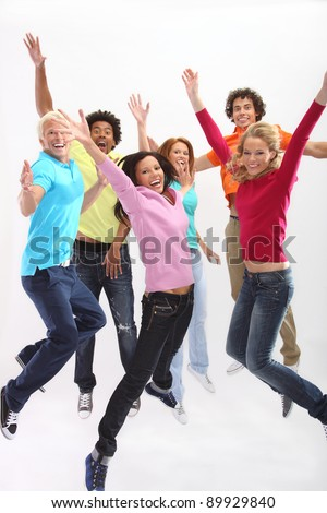 Young people jumping with joy - stock photo