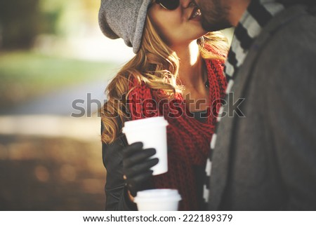 Young people kissing outdoors - stock photo