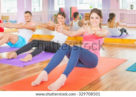 Young people lead a healthy lifestyle, exercise and engaged in fitness room. Exercise strengthens a person physically and make them more happy! - stock photo