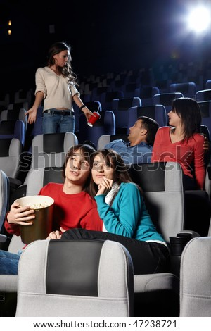 Young people look cinema at a cinema - stock photo