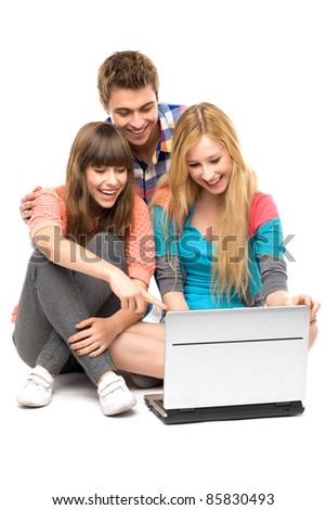 Young people looking at laptop - stock photo