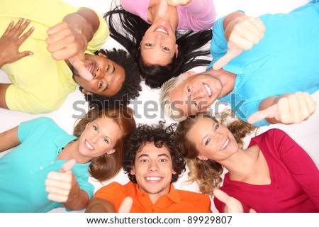 Young people lying down,gesturing thumb up sign - stock photo