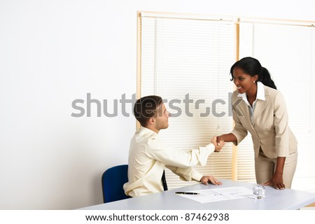 Young people multinational business greetings and introductions. - stock photo