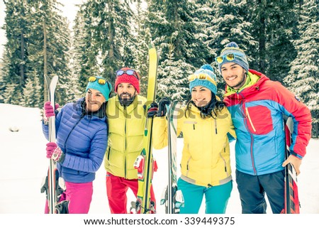 Young people on a winter vacation - Tourists having fun while skiing - Concepts about winter,christmas,winter vacation and skiing - stock photo