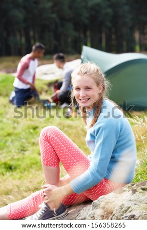 Young People On Camping Trip In Countryside - stock photo