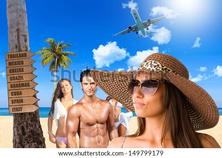 Young people on the beach enjoying their vacation Travel concept - stock photo