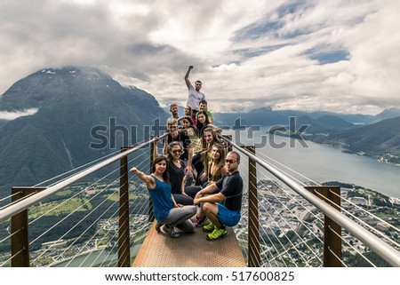 Young people on the top of mountain, Alesund, Norway