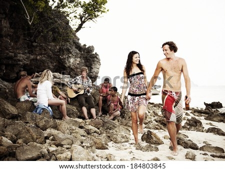 Young People Partying On a Beach - stock photo