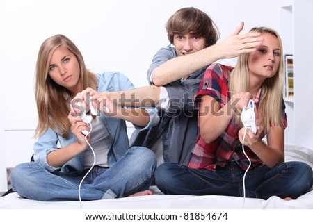 Young people playing computer games - stock photo
