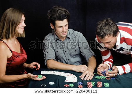 young people playing poker - stock photo