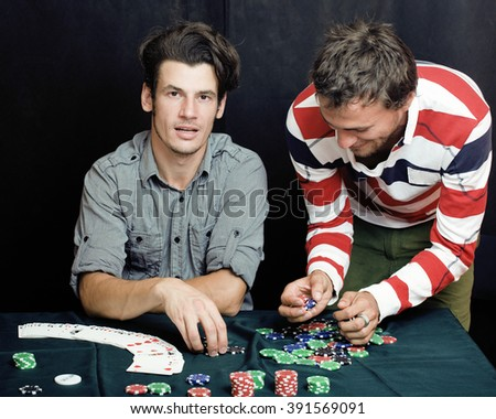 young people playing poker off-line tournament, friends party concept