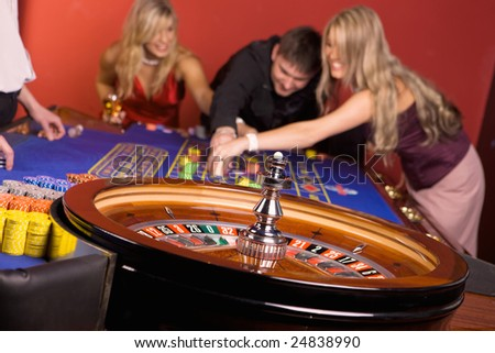 Young people playing roulette, casino