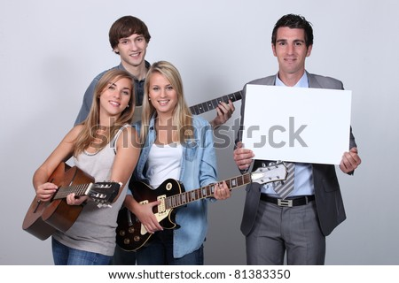 Young people playing the guitar - stock photo
