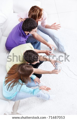 Young people playing video games - stock photo
