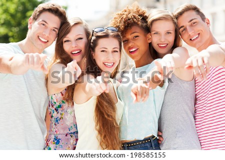 Young people pointing at you - stock photo