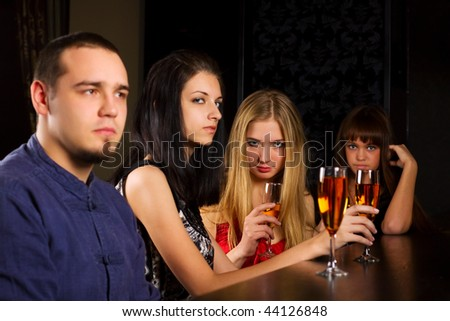 Young people relaxing in a bar. - stock photo