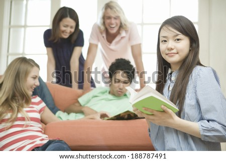 young people relaxing in room