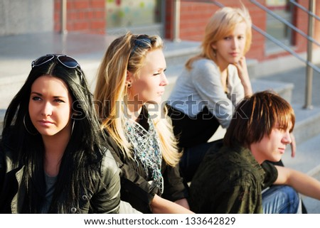 Young people relaxing on the city street - stock photo