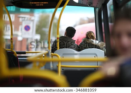 Young people riding a public transport to work - stock photo