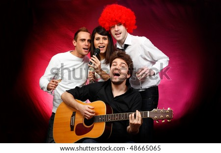 young people singing together at a party - stock photo