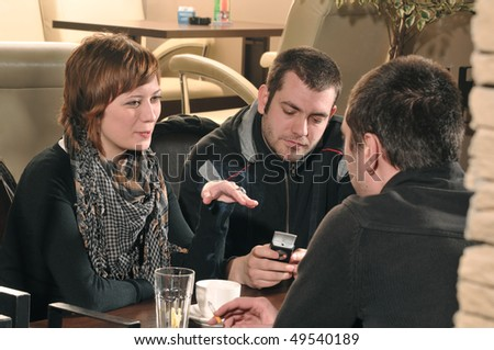 Young people sitting in cafe and talking