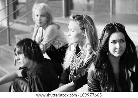 Young people sitting on the steps - stock photo