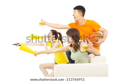 young people so excited to yelling and while watching ball game - stock photo