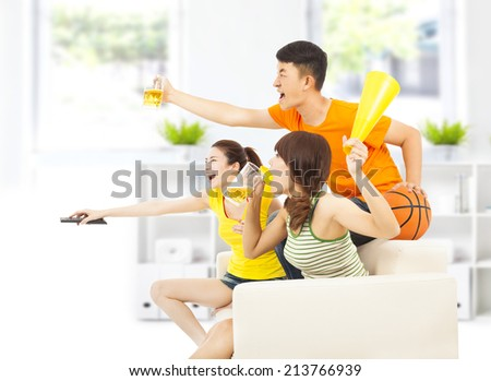 young people so excited to yelling and while watching tv - stock photo