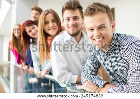Young people standing on line in real authentic life - stock photo