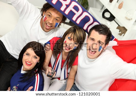 Young people supporting French sports team - stock photo