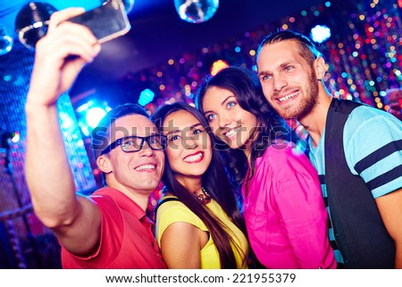 Young people taking selfie at party - stock photo
