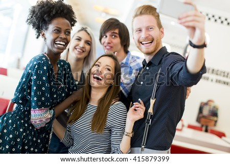 Young people taking selfie in the diner - stock photo