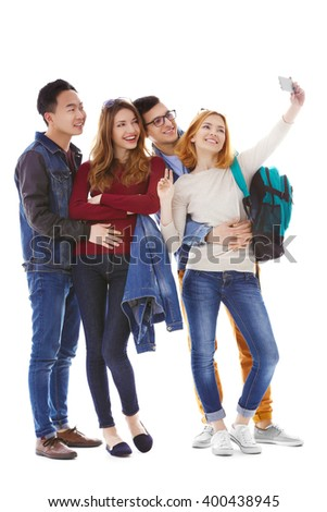 Young people taking selfie with mobile phone isolated on white - stock photo