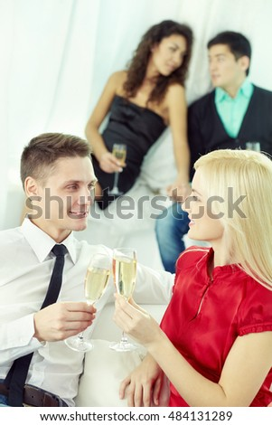 Young people toasting and communicating with each other