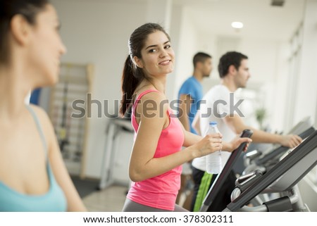 Young people training in the gym - stock photo