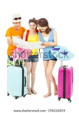 young people using a map to look for local landmark - stock photo