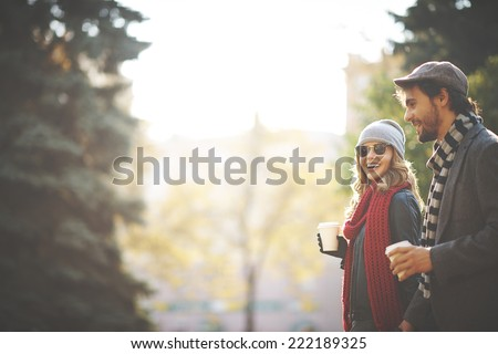 Young people walking in autumn - stock photo