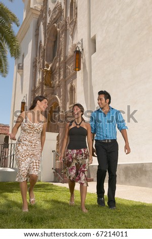 Young people walking outdoors - stock photo